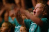With arms flailing Taylor, 5, sings along with the audience to The Sunburned Sailor as the London Symphony Orchestra perfroms during the LSO Family Concert at Peabody, July 24, 2003. (Photo: Joanna Kaney Olivari)